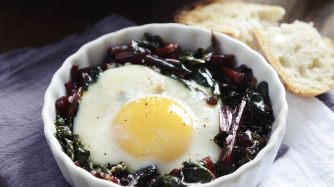 eggs baked on beet greens